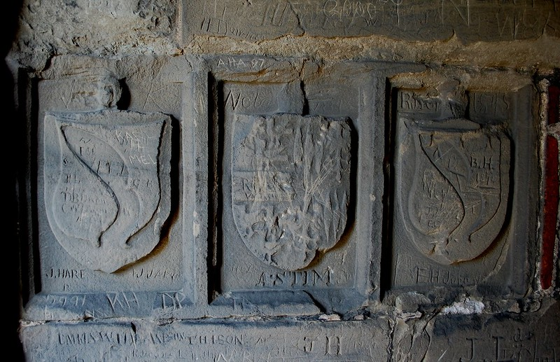Carvings in the main tower stairway at Ashby de la Zouch Castle.